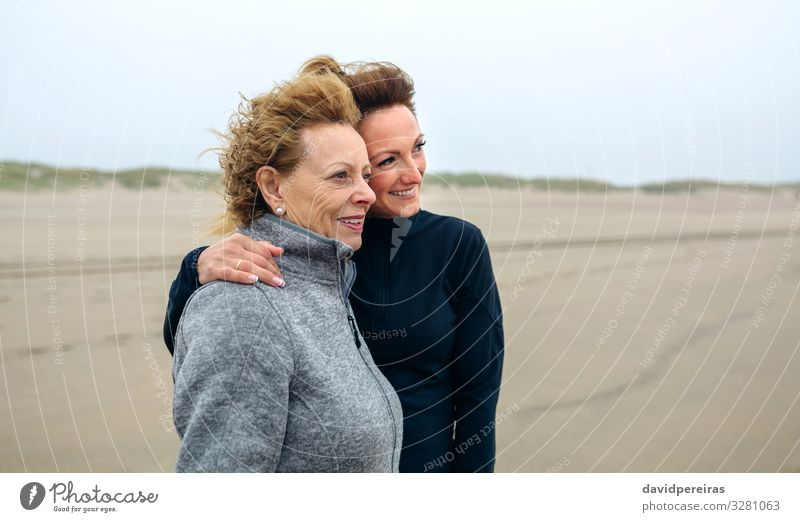 Two women looking at sea on the beach in autumn Lifestyle Joy Happy Beautiful Beach Ocean Human being Woman Adults Mother Grandmother Family & Relations Sand