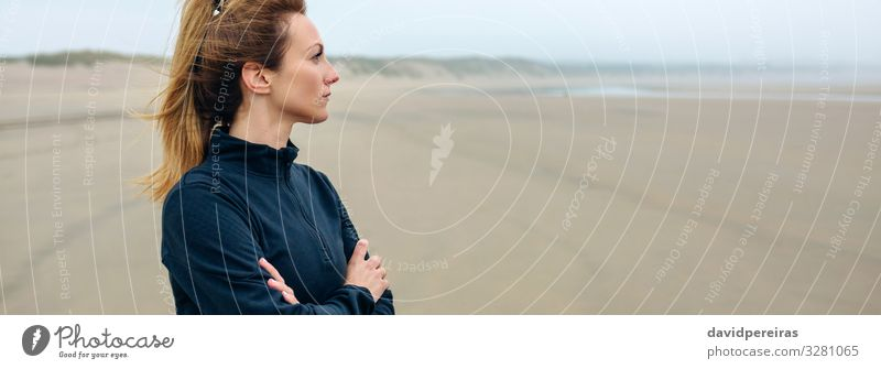 Woman looking at sea Lifestyle Beautiful Meditation Beach Ocean Internet Human being Adults Sand Autumn Fog Think Sadness Authentic Loneliness Future worried