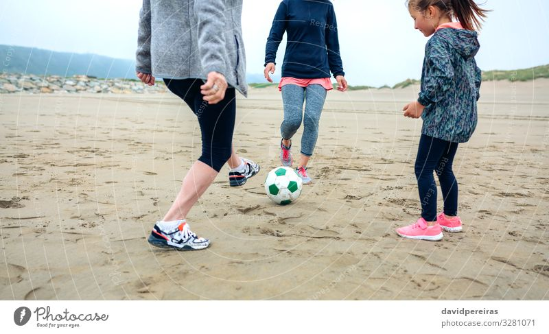 Three generations female playing soccer on the beach Lifestyle Joy Happy Playing Beach Child Human being Woman Adults Mother Grandmother Family & Relations Feet
