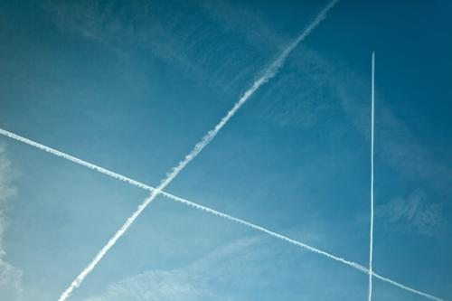 air traffic Vapor trail Carbon dioxide Triangle Aviation Airplane Worm's-eye view Sky Heaven Climate Climate change Vacation & Travel Travel photography Clouds