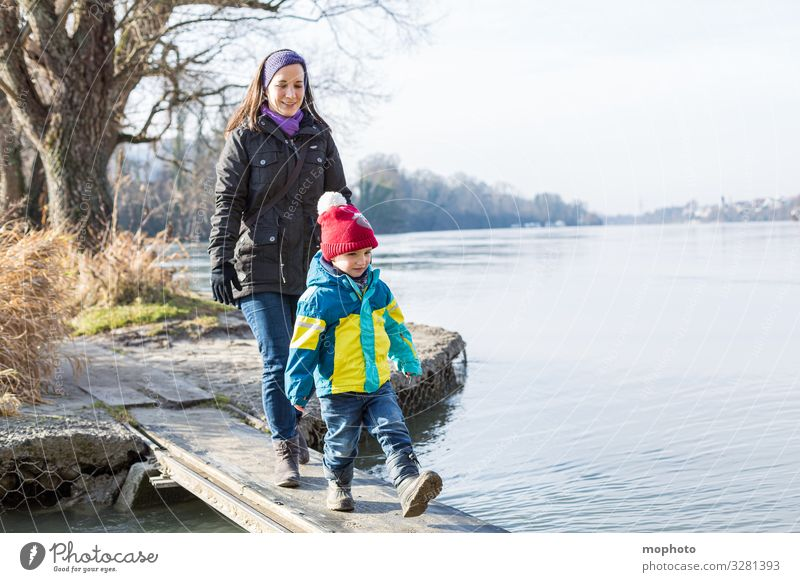 Mother walks with her little son over a wooden jetty on the water, Rhine Woman Human being Fear watch balance bridge Family River Going in common Wooden bridge