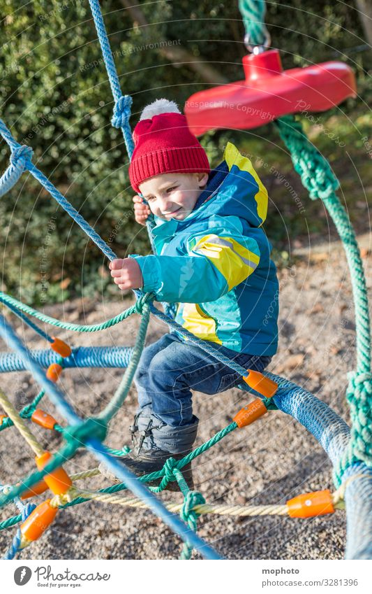 Boy on a climbing frame Toddler out three years experience Joy Scaffolding Jacket Boy (child) Child Infancy climbing scaffold Climbing Laughter smile Manly cap