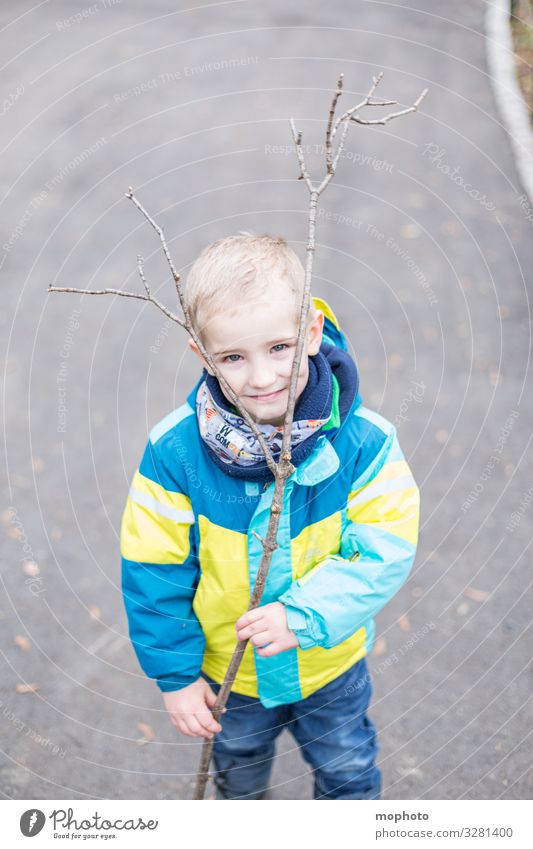 Boy with a branch for antlers Toddler Branch out three years Joy cheerful Jacket Boy (child) Child Infancy Head Laughter smile Manly game Playing plays Winter