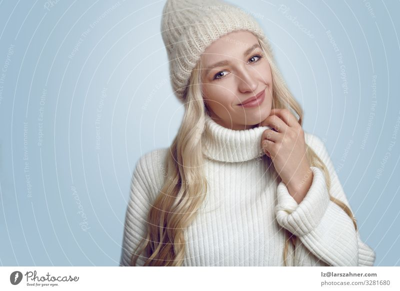 Beautiful woman in white knitted sweater and hat Happy Face Winter Woman Adults 1 Human being 18 - 30 years Youth (Young adults) Warmth Sweater Hat Blonde