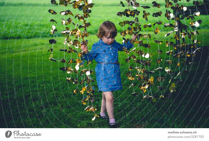 Girl and golden garland on green meadow 1 Human being 3 - 8 years Child Infancy Nature Summer Meadow Dress Playing Happy Natural Blue Gold Green Joy