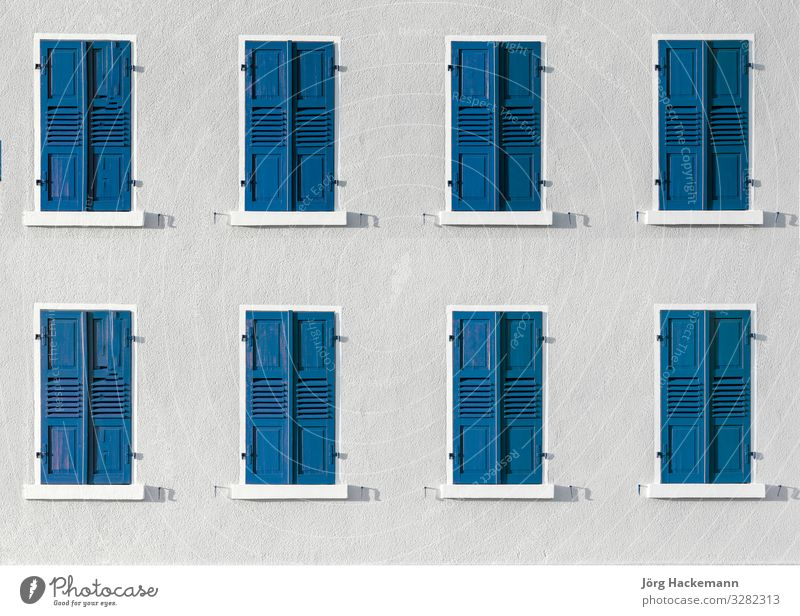 wooden shutter in intensive color gives a harmonic background Harmonious Architecture Facade Blue White closed Germany Icon Intensive Repeating row Shutter