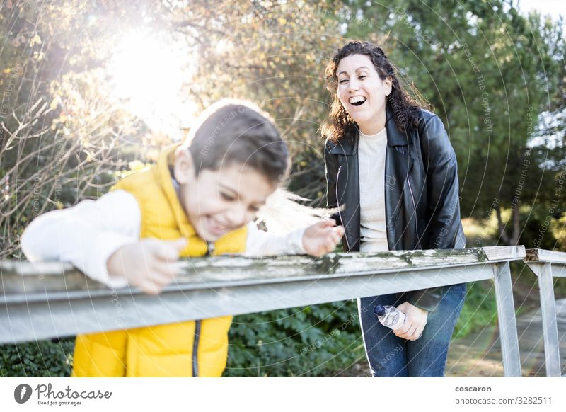 Mother and son playing and laughing outdoors Woman Child Human being Vacation & Travel Nature Man Summer Plant Beautiful Sun Leaf Joy Forest Mountain Lifestyle