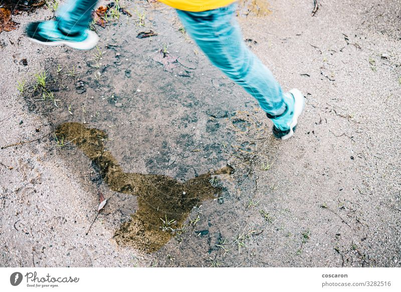 Kid legs reflection jumping a puddle Child Human being Vacation & Travel Nature Youth (Young adults) Summer Blue Joy Winter Street Lifestyle Legs Autumn Spring