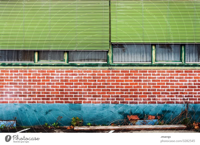 façade Facade Part of a building Brick wall Window Roller shutter green turquoise Orange Old Decline Backyard half-opened forsake sb./sth.