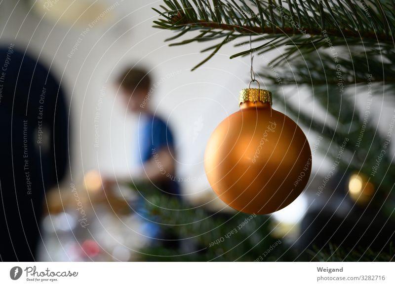 Christmas Harmonious Christmas & Advent Child 1 Human being Gold Desire Glitter Ball Christmas tree Embellish Preparation Colour photo Interior shot