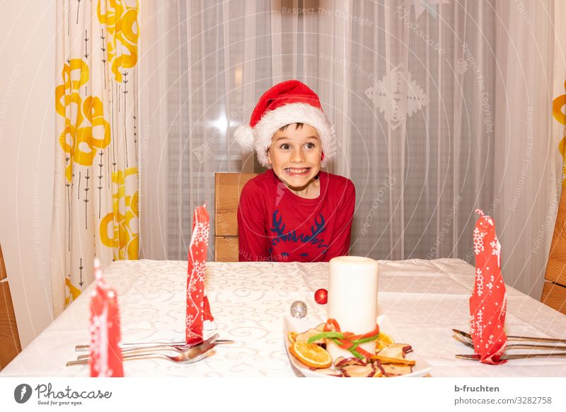 Christmas Eve Eating Dinner Banquet Cutlery Style Joy Event Feasts & Celebrations Christmas & Advent New Year's Eve Child Boy (child) 1 Human being 8 - 13 years
