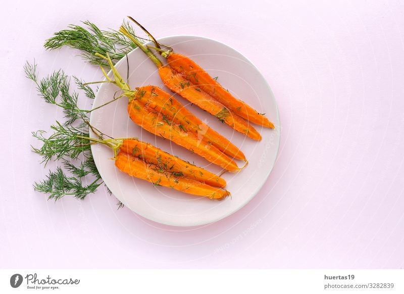 Delicious roasted carrots from above Food Vegetable Herbs and spices Lunch Dinner Vegetarian diet Diet Healthy Eating Fresh Natural Above Orange Pink Carrot