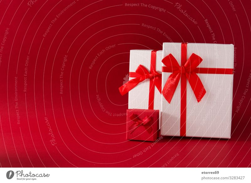Assorted white gift boxes on red background. Copy space Gift Christmas & Advent Box bow String Present Day Red Birthday Vacation & Travel Feasts & Celebrations