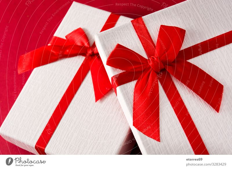 Assorted white gift boxes on red background. Gift Christmas & Advent Box Carton Bow String Present Day Red Birthday Vacation & Travel Feasts & Celebrations