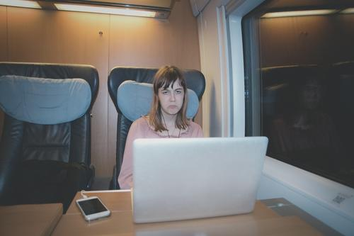 grumpy teenager Child Girl Youth (Young adults) 13 - 18 years Vacation & Travel Train travel Train compartment Night Seating Table electronical equipment