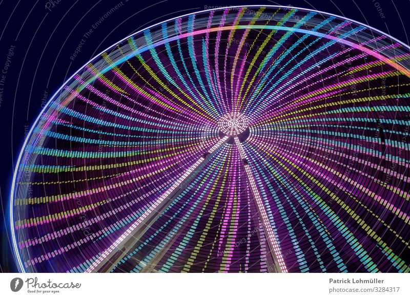 Swing in the round Leisure and hobbies Ferris wheel Night sky Steel Glittering Gigantic Beautiful Blue Green Moody Joy Movement Energy Relaxation Round