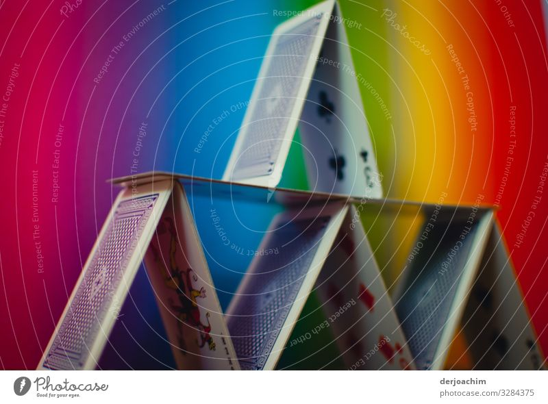 Cards gimmick / architecture. Playing cards built up to a house. The background colors are colorful. Design Harmonious Game of cards Architecture