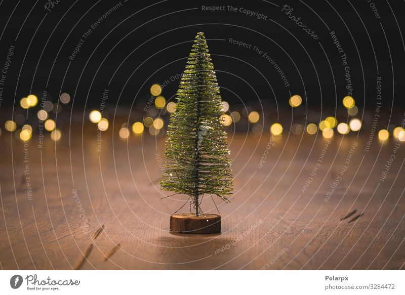 Christmas tree decoration on a wooden surface Christmas & Advent Tree Winter Wood Happy Feasts & Celebrations Small Brown Design Decoration Bright Gold