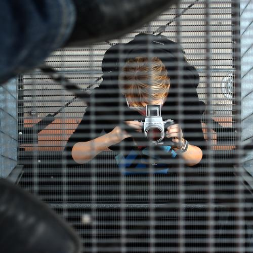 photographing photographers Feminine Woman Adults 2 Human being Artist Tower Manmade structures Building Stairs Platform Footwear Blonde Short-haired Grating