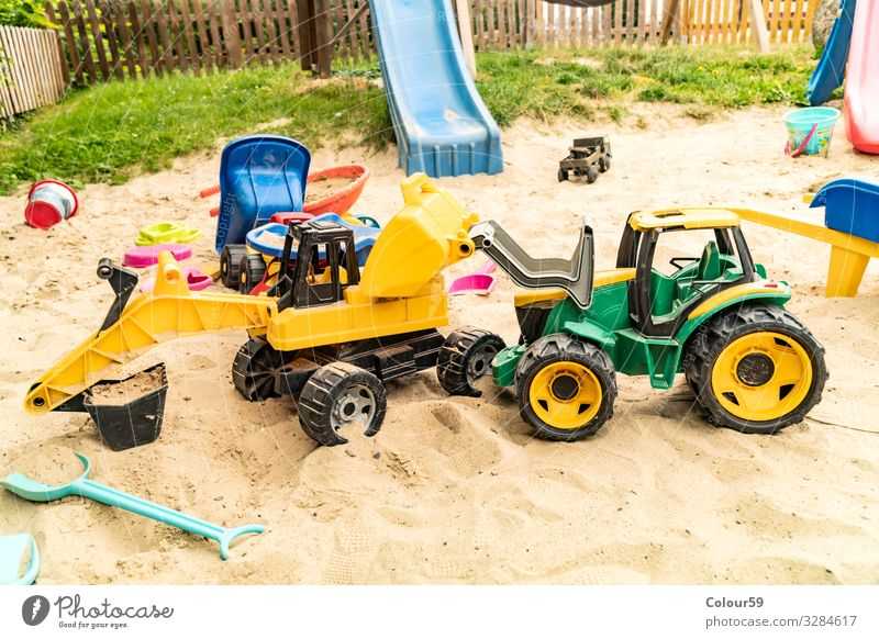 Colourful toys in the sandbox Joy Playing Children's game Summer Beach Kindergarten Nature Sand Toys Plastic Positive Yellow Green Background picture Excavator