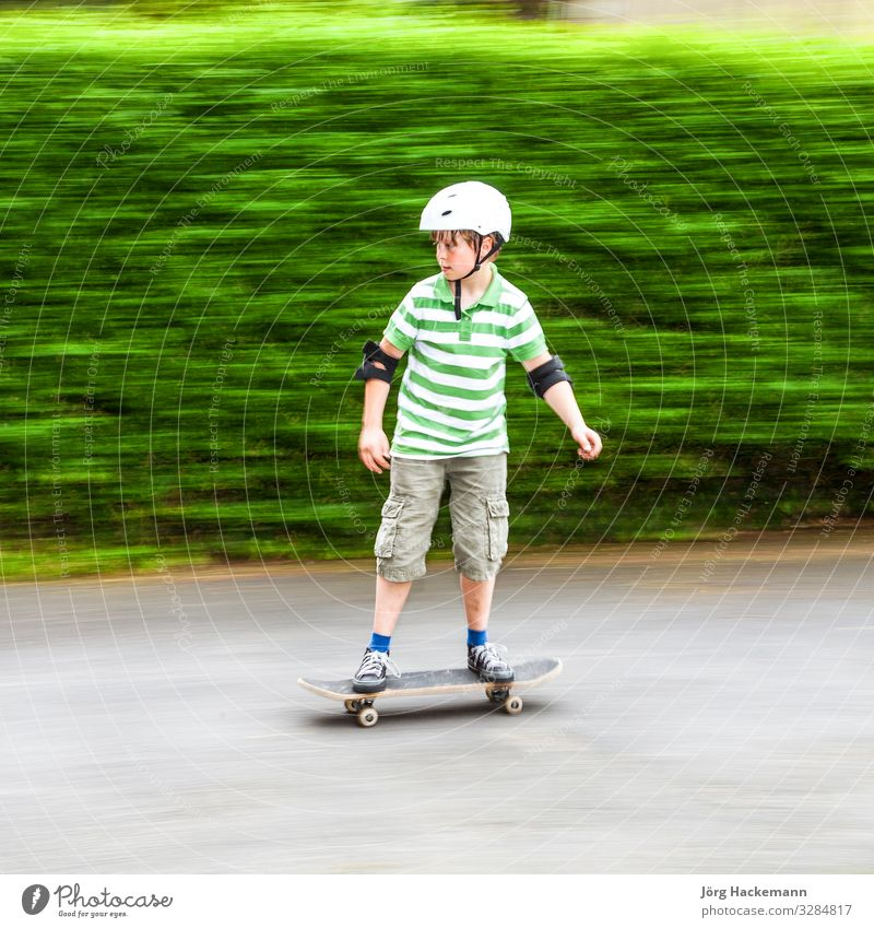 boy skating with speed Joy Leisure and hobbies Sports Boy (child) Nature Park Transport Vehicle Clothing Toys Speed White Safety Protection Roller Skateboard