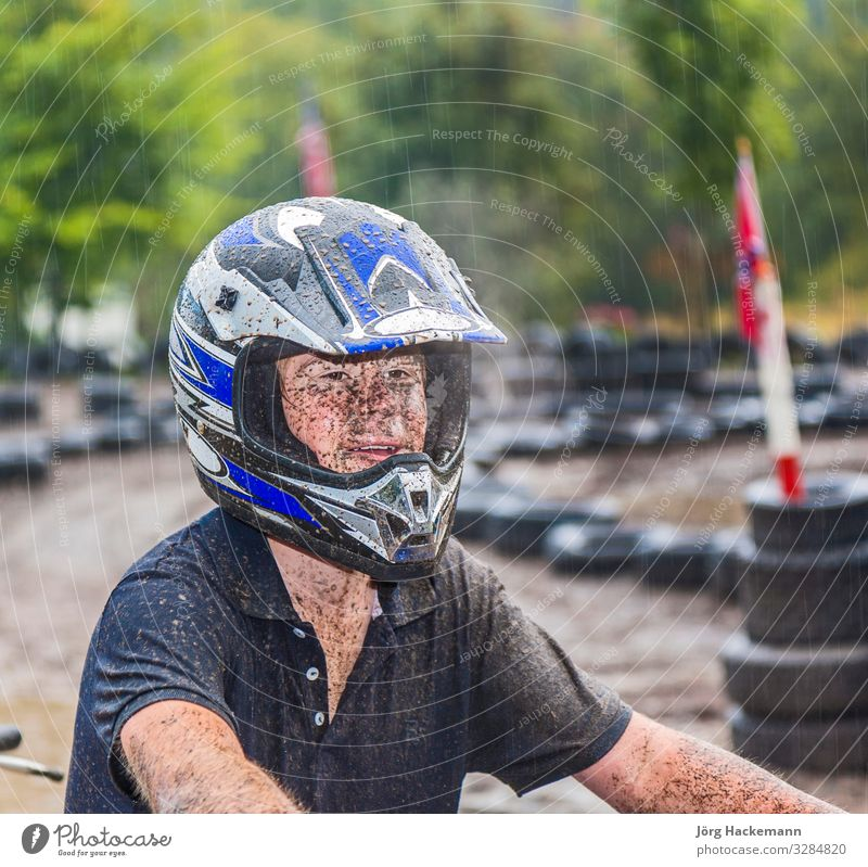 boy enjoys riding his Quad at the parcour Joy Sports Engines Boy (child) Youth (Young adults) Nature Weather Rain Driving Wet Speed Kart Buggy (Motorbike)