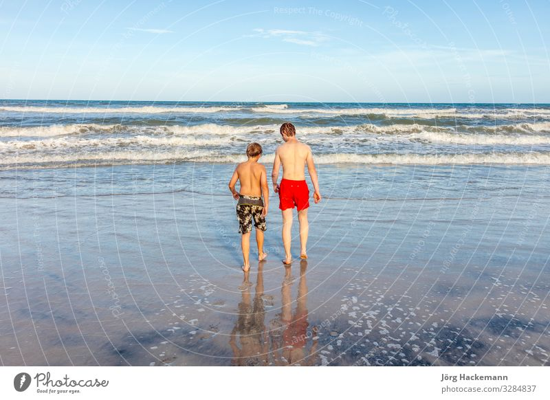 boys relaxing at the beach Child Vacation & Travel Nature Youth (Young adults) Blue Beautiful Sun Ocean Joy Beach Face Warmth Coast Happy Boy (child) Playing