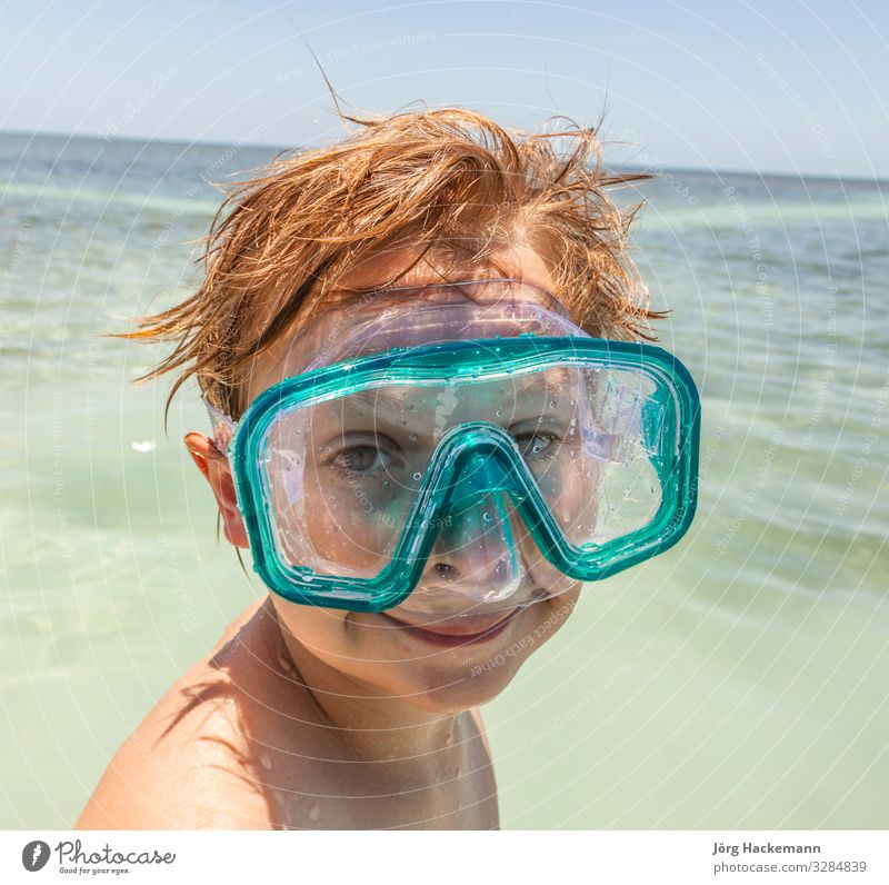 boy with diving mask enjoys the ocean Joy Happy Beautiful Body Skin Face Relaxation Leisure and hobbies Vacation & Travel Sun Ocean Waves Dive Child Boy (child)