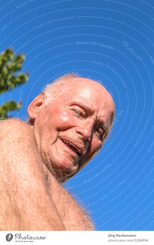 senior sits in the chair in the garden Lifestyle Joy Happy Relaxation Summer Sun Garden Retirement Man Adults Grandfather Nature Sky Old Smiling Blue Green