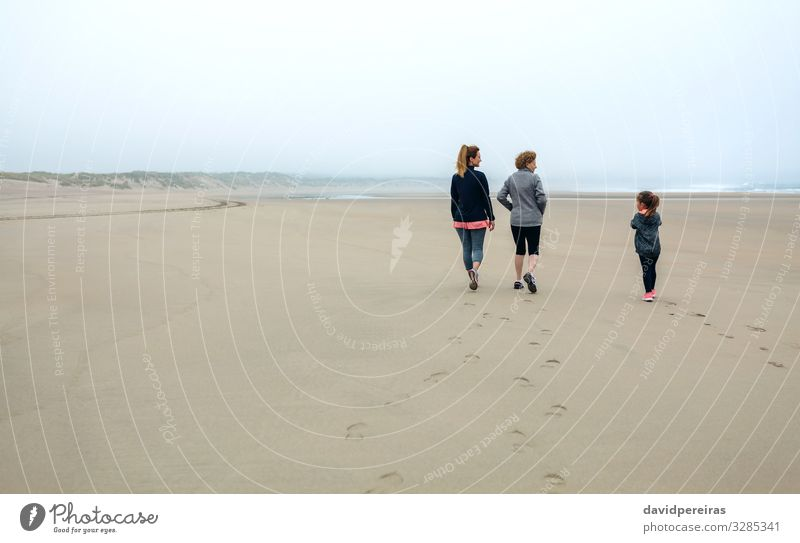 Three generations female walking on the beach Lifestyle Beach Child Human being Woman Adults Mother Grandmother Family & Relations Sand Sky Autumn Fog Footprint