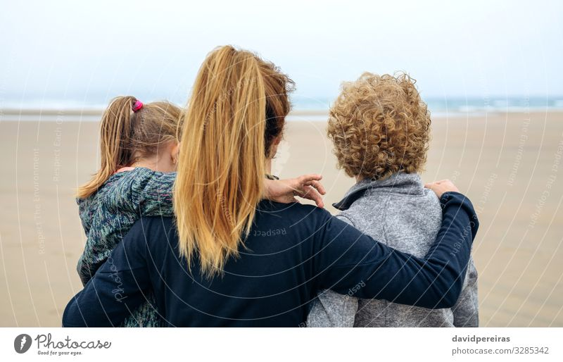 Back view of three generations female looking at sea Lifestyle Joy Happy Beautiful Beach Ocean Child Human being Woman Adults Mother Grandfather Grandmother