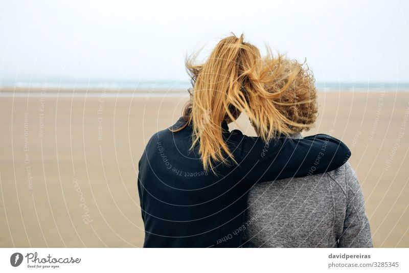 Back view of senior and young woman looking at sea Lifestyle Happy Beautiful Calm Beach Ocean Human being Woman Adults Mother Grandmother Family & Relations