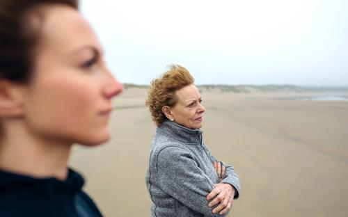 Two women looking at sea Lifestyle Beautiful Meditation Beach Ocean Human being Woman Adults Mother Grandmother Family & Relations Sand Autumn Wind Fog Love