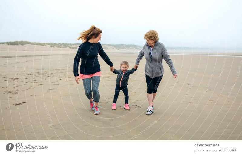 Three generations female running on the beach Lifestyle Joy Happy Playing Beach Child To talk Human being Woman Adults Mother Grandmother Family & Relations