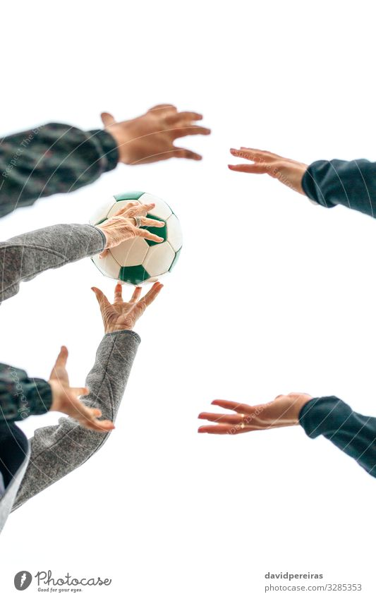 Three generations playing with soccer ball Lifestyle Joy Playing Beach Child Human being Woman Adults Mother Grandmother Family & Relations Hand Sky Autumn Fog