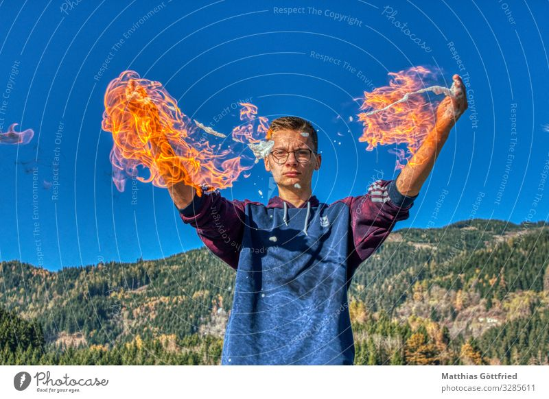 Play with fire Art Youth culture Nature Fire Sky Cloudless sky Climate change Discover Glittering Aggression Exceptional New Athletic Warmth Blue Red Bravery