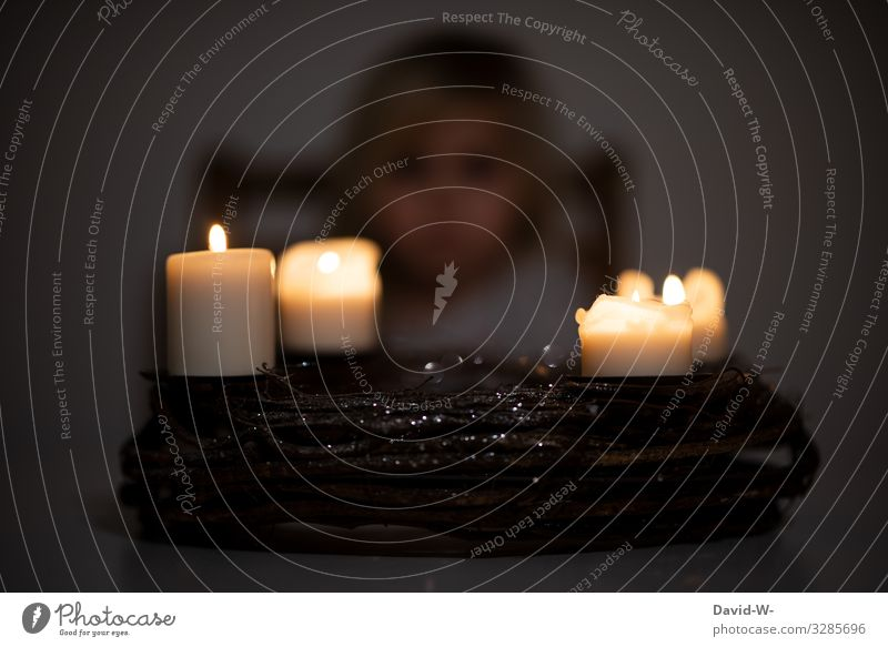 burning candles on an advent wreath with a child in the background Christmas & Advent Christmas wreath Child 4 four Illuminate Infancy Candlelight somber