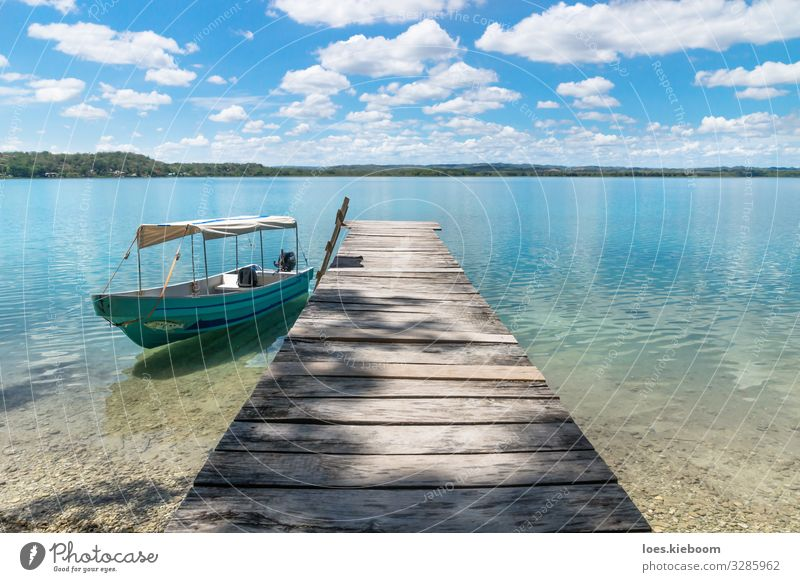 Boat at a dock at lake Itza Relaxation Vacation & Travel Far-off places Sightseeing Summer Sun Beach Nature Sky Clouds Waves Lake Boating trip Fishing boat