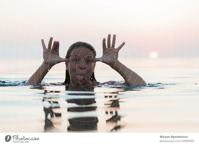 Young woman goofing around in the sea Joy Swimming & Bathing Vacation & Travel Summer Summer vacation Ocean Human being Feminine Youth (Young adults) Woman