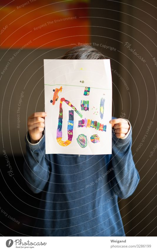 Boy with self-painted picture Parenting Education Kindergarten Child School Study Classroom Schoolchild schuler Boy (child) 1 Human being Draw Paper