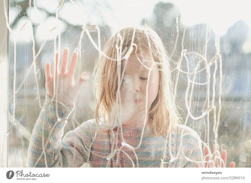 Girl standing outside behind a pane of glass with her eyes closed Living or residing House (Residential Structure) Decoration Fairy lights girl 1 Human being