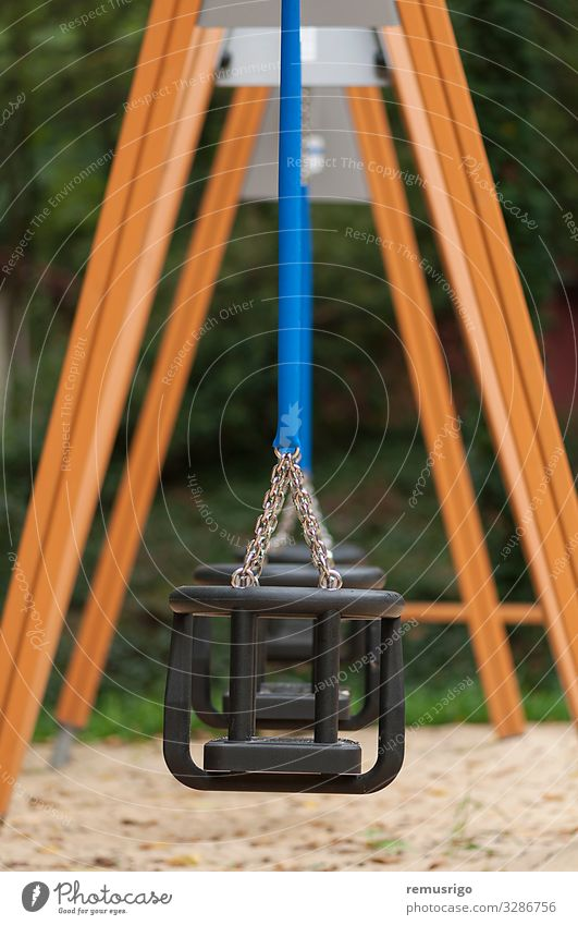 Empty swing for children Relaxation Kindergarten Child Infancy Park Playground Blue Safety chain iron wood Colour photo Exterior shot Deserted Day