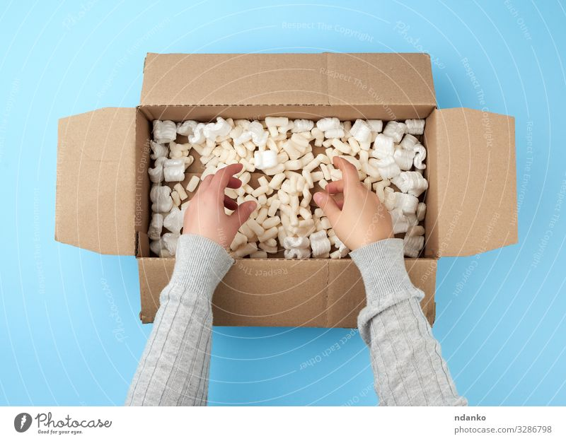 female hands hold an empty open box Craft (trade) Mail Business Hand Bottom Transport Container Paper Packaging Package Above Clean Brown Yellow White backdrop