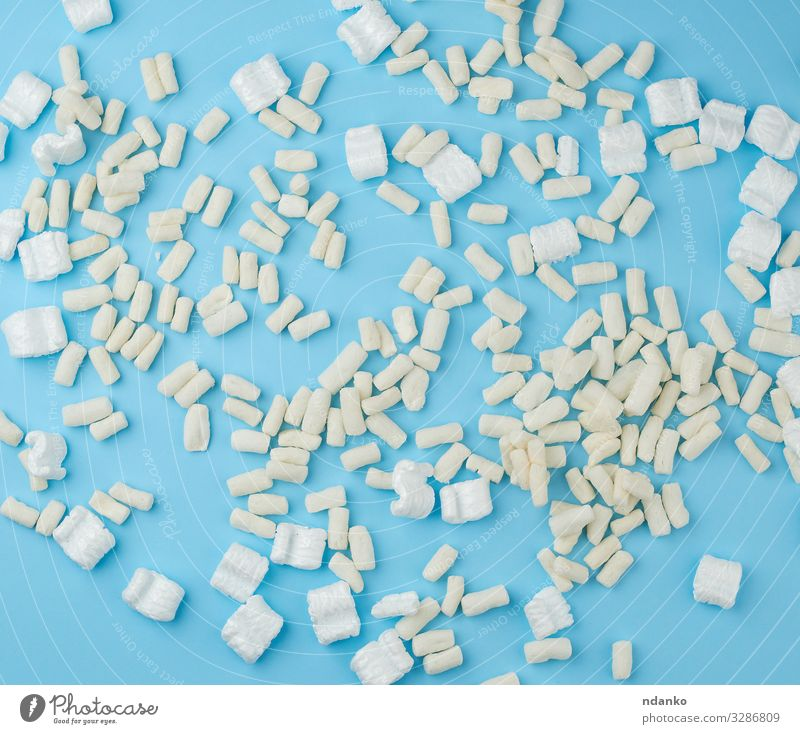 scattered white foam for packaging parcels Mail Watercraft Container Packaging Package Plastic Soft Blue White Protection background box bubble extender fill