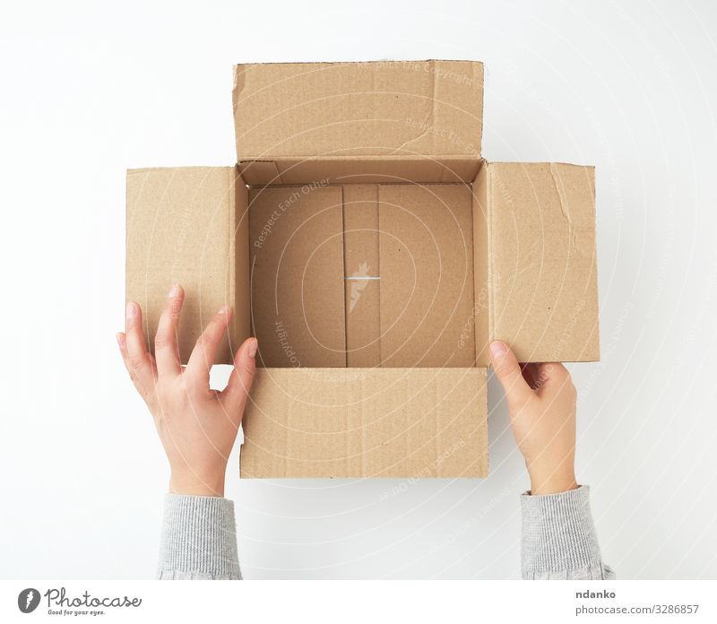 open empty square brown cardboard box Craft (trade) Business Hand Bottom Transport Container Pack Paper Packaging Package Clean Brown Yellow White Hold Storage
