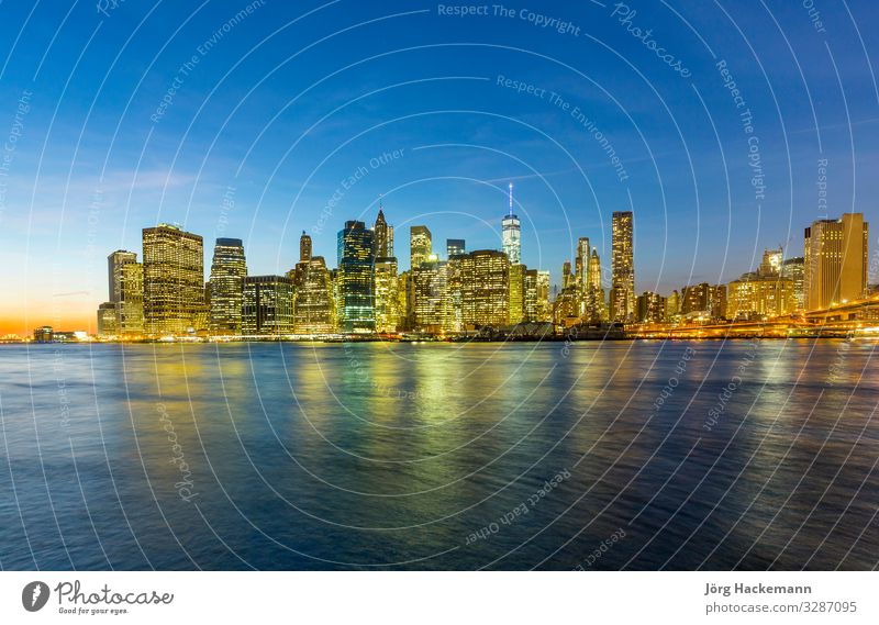 Manhattan waterfront at night Vacation & Travel Office Business River Town Downtown Skyline High-rise Bridge Building Architecture Retro New York USA america