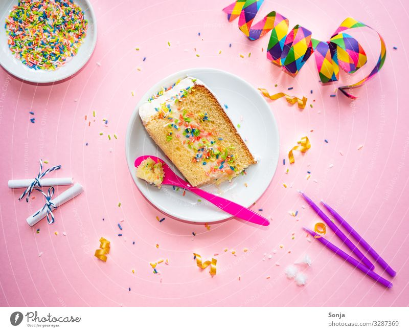 Cake piece with colorful crumbles and streamers Food Piece of gateau Granules To have a coffee Plate Spoon Overweight Feasts & Celebrations Carnival Birthday
