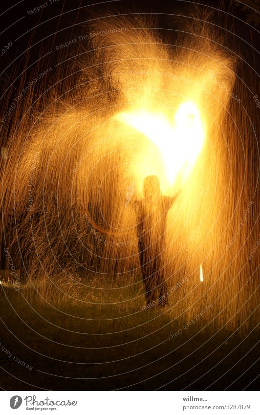 Man stands in the middle of a shower of sparks with a burning heart Human being Fire Spark shower of fire Hot Heart Burn Love Valentine's Day Infatuation