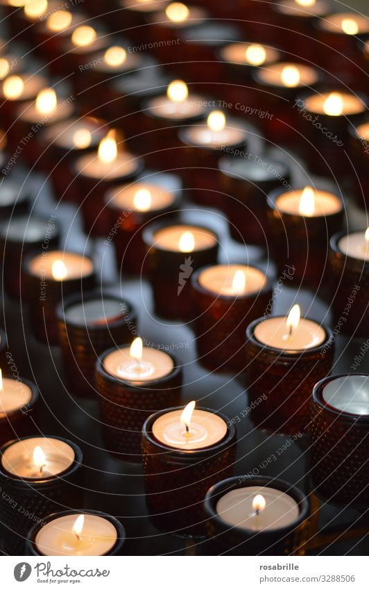 Rows of candles in glasses in a church as a symbol of prayer Fire Church shoulder stand Illuminate Dark Hot Bright Many Trust To console Grateful Honest Hope