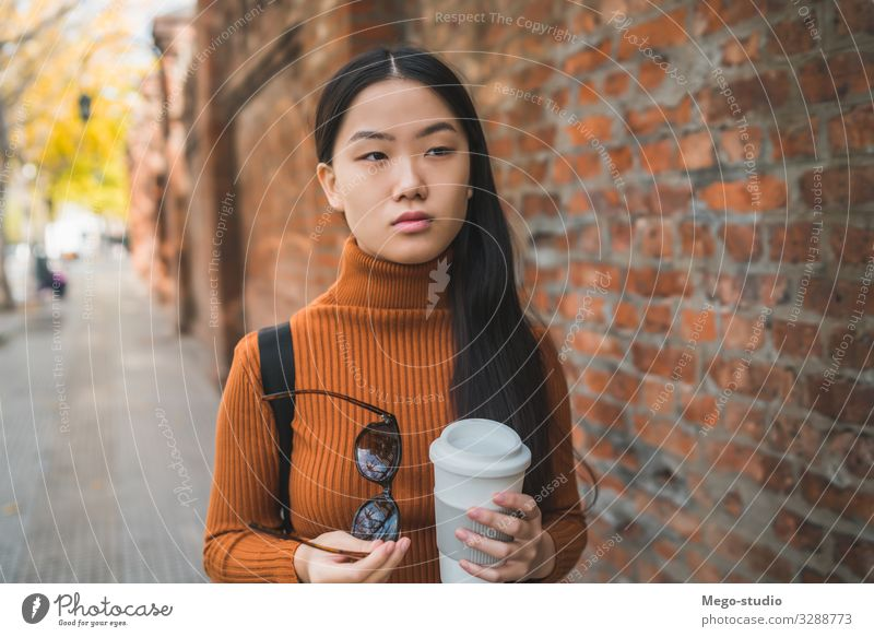 Asian woman holding a cup of coffee. Beverage Drinking Coffee Lifestyle Happy Beautiful Relaxation Human being Woman Adults To enjoy Smiling Happiness Hot